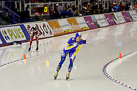 Calgary - December 5, 2009 - Essent ISU World Cup Speedskating at the Olympic Oval in Calgary.  Swedish Speedskater Johan Rojler finishes ahead of Canadian Lucas Makowski in the A Division of the men's 5000m event.  Rojler finished 14th in 6:23.63 while Makowski finished 17th in 6:24.72...©2009, Sean Phillips.http://www.Sean-Phillips.com