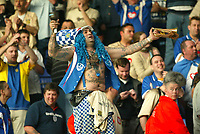 Photographer: Scott Heavey<br />Ipswich Town V Portsmouth. 18/04/03.<br />John Portsmouth Football Club Westwood (real name) celebrates Pompeys promotion despite the 3-0 defeat during this Nationwide Division one match at Portland Road.