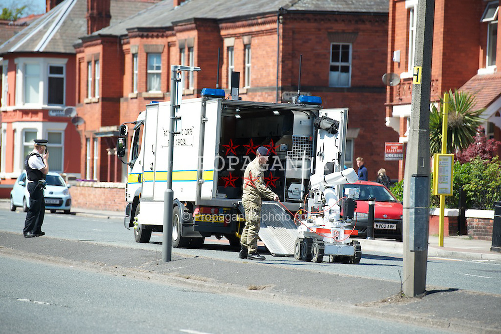 LIVERPOOL, ENGLAND - Saturday, May 25, 2013: A bomb disposal robot unit and police at the scene of a 'suspicious package' as a shoe box with pictures of bombs was found outside the Territorial Army barracks on Aigburth Road in South Liverpool. (Pic by David Rawcliffe/Propaganda)