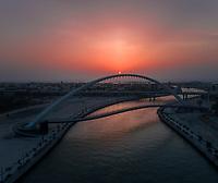 Aerial view of the Tolerance pedestrian Bridge in Dubai at sunset, U.A.E.