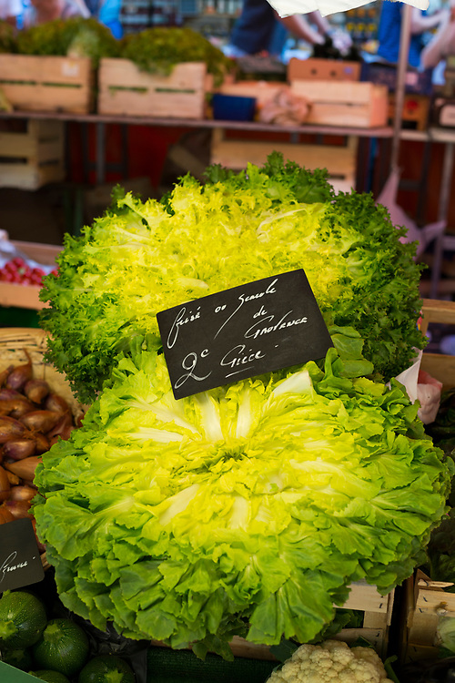 Fresh lettuce on display and for sale at Saturday market in Aix-en-Provence, France
