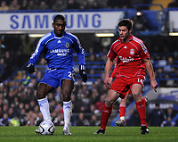 Photo: Tony Oudot/Sportsbeat Images.<br /> Chelsea v Liverpool. Carling Cup, Quarter Final. 19/12/2007.<br /> Salomon Kalou of Chelsea with Xabi Alonso of Liverpool
