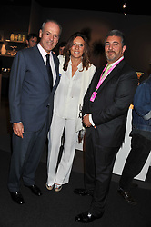 Left to right, MASSIMO & SARA CARELLO and ADRIAN SASSOON at the Private View of the Pavilion of Art & Design London 2011 held in Berkeley Square, London on 10th October 2011.