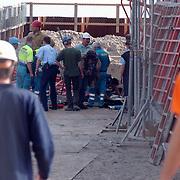 Bouwongeval Gooimeerpromenade Huizen, man bekneld onder betonschot