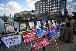 © Licensed to London News Pictures. 03/06/2018. London, UK. Pictures of the eight victims are placed at the scene of the attack ahead of a minutes silence for the victims of the 2017 London Bridge Terror attack, held on London Bridge. Eight people were killed and 48 were injured when a van was deliberately driven into pedestrians on London Bridge. Three occupants then ran to the nearby Borough Market area carrying knives and fake explosives. Photo credit: Ben Cawthra/LNP