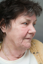 Older woman; looking to the side,