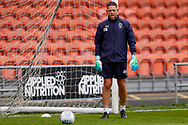 Wimbledon goalkeeping coach Ashley Bayes warms up the goalkeepers during the EFL Sky Bet League 1 match between Blackpool and AFC Wimbledon at Bloomfield Road, Blackpool, England on 20 October 2018.