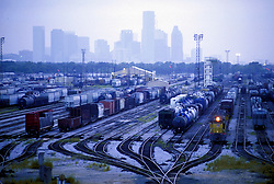 Rail yard with downtown Houston skyline in background.