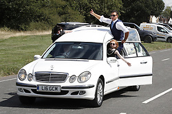 © Licensed to London News Pictures. 21/08/2018. Epsom, UK. The funeral hearse carrying the coffin of traveller Mikey Connors races with pony and traps before it makes it's way to Epsom cemetery for a burial service. 32 year-old Mikey Connors, the nephew of My Big Fat Gypsy Wedding star Paddy Doherty, was killed when his horse-and-cart was hit by a car in Thamesmead on July 28. Photo credit: Peter Macdiarmid/LNP