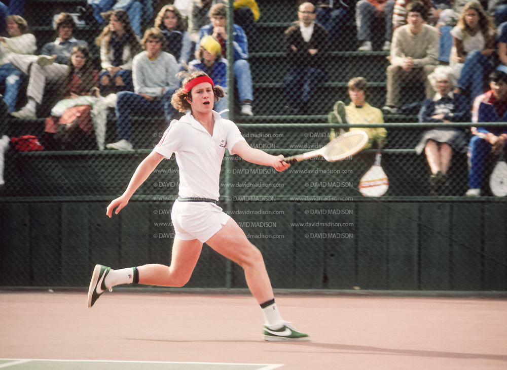 PALO ALTO, CA -  APRIL 14:  John McEnroe of Stanford University hits a forehand during an NCAA singles tennis match against Cal played at Stanford University on April 14, 1978 in Palo Alto, Calfiornia.  McEnroe was a college freshman at the time.  (Photo by David Madison/Getty Images) *** Local Caption *** John McEnroe