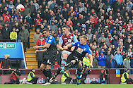 Ciaran Clark of Aston Villa (C) in action with Andrew Surman (L) and Matt Ritchie of Bournemouth.<br /> Barclays Premier League match, Aston Villa v AFC Bournemouth at Villa Park in Birmingham, The Midlands on Saturday 09th April 2016.<br /> Pic by Ian Smith, Andrew Orchard Sports Photography.
