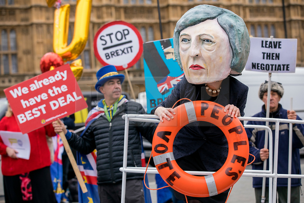 """© Licensed to London News Pictures. 15/01/2019. London, UK. A campaigner wearing a Theresa May mask stands on the bow of the """"HMS Brexit"""" in Old Palace Yard opposite Parliament. MPs will vote on Prime Minister Theresa May's Brexit deal this evening. Photo credit: Rob Pinney/LNP"""
