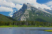 Canoeing on Vermillion Lakes in the Rocky Mountains. Mt Rundle. <br />Banff National Park<br />Alberta<br />Canada