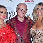 Modesta Vzesniauskaite, John Caudwell and Christine McGuinness arrive at Float Like A Butterfly Ball for Caudwell Children Charity at Grosvenor House Hotel on 16 November 2019, London, UK.