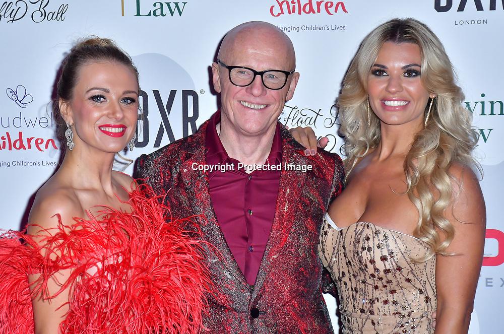 Modesta Vzesniauskaite, John Caudwell and Christine McGuinness arrive at Float Like A Butterfly Ball for Caudwell Children Charity at Grosvenor House Hotel on 16 November 2019, London, UK.
