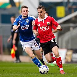 Oldham Athletic's Carl Winchester chases Bristol City's Joe Bryan  - Photo mandatory by-line: Matt McNulty/JMP - Mobile: 07966 386802 - 03/04/2015 - SPORT - Football - Oldham - Boundary Park - Oldham Athletic v Bristol City - Sky Bet League One