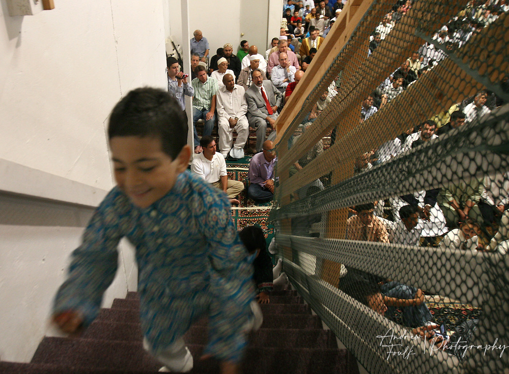 /Andrew Foulk/For The Californian/.A young worshiper races up the stairs at Islamic Center of Temecula as the rest of the men prepare for prayer during services for the final day of Ramadan.