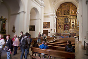 The Alhambra Palace and fortress complex located in Granada, Andalucia, Spain. Tourists inside the Church of Santa Maria de la Alhambra.