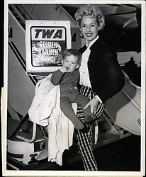 1962 - Idlewild Airport, N.Y. June 5: ''Mommy, I'm Not dressed'', exclaims little Melanie Griffith 9 months, after arriving aboard a TWA Super-G Constellation from Los Angeles. The embarrassed Miss and the her mother Mrs. Peter Griffith, better known in modeling circles as Tippi Hedren, were returning from TWO-week visit with Melanie's grandparents. (Credit Image: © Keystone Pictures USA/ZUMAPRESS.com)