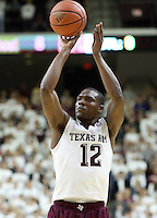 Texas A&M's Jalen Jones (12) shoots a three point shot against South Carolina during the first half of an NCAA college basketball game, Saturday, Feb. 6, 2016, in College Station, Texas. South Carolina won 81-78. (AP Photo/Sam Craft)
