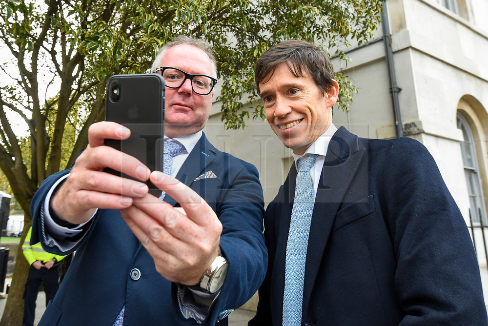 © Licensed to London News Pictures. 30/10/2019. LONDON, UK. Rory Stewart MP (R), former Secretary of State for International Development, has a selfie photo taken with a member of the public opposite the Houses of Parliament.  Photo credit: Stephen Chung/LNP
