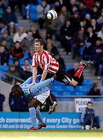 Photo: Jed Wee.<br /> Manchester City v Sunderland. The Barclays Premiership. 05/03/2006.<br /> <br /> Sunderland's Kevin Kyle hitches a ride on the back of Manchester City's Micah Richards.