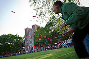 Frisbee discs fly through the air on Mac Field of Grinnell College during Grinnell's attempt to break the Guinness world record for most frisbee discs thrown simultaneously. May 1st, 2012 was chosen as the ideal date for Grinnell Day and this record breaking attempt as the date matches the town's zip code, 50112. BEN BREWER/Grinnell College