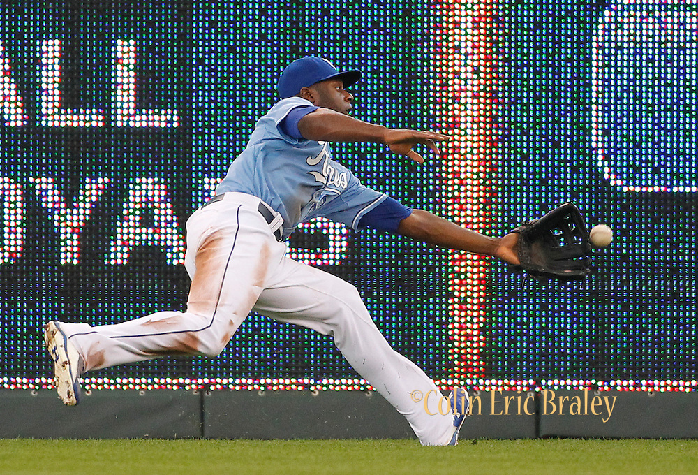 Kansas City Royals center fielder Lorenzo Cain is unable to catch a hit by Boston Red Sox' Brock Holt in the eighth inning of a baseball game against the at Kauffman Stadium in Kansas City, Mo., Sunday, June 21, 2015. The Red Sox won 13-2. (AP Photo/Colin E. Braley)