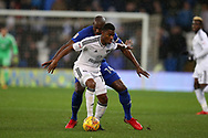 Floyd Ayite of Fulham gets the ball ahead of Sol Bamba of Cardiff city . EFL Skybet championship match, Cardiff city v Fulham at the Cardiff city stadium in Cardiff, South Wales on Boxing Day, Tuesday 26th December 2017.<br /> pic by Andrew Orchard, Andrew Orchard sports photography.