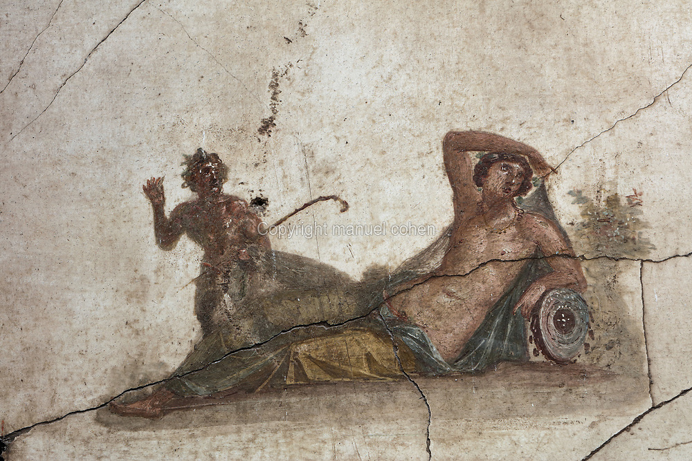 Fresco detail of a reclining woman, painted after 62 AD in Pompeiian Fourth Style, in the House of the Vettii, one of the largest houses in Pompeii, in the Parco Archeologico di Pompei, or Archaeological Park of Pompeii, Campania, Italy. Pompeii was a Roman city which was buried in ash after the eruption of Vesuvius in 79 AD. The site is listed as a UNESCO World Heritage Site. Picture by Manuel Cohen