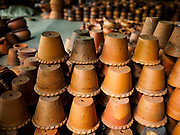 02 AUGUST 2018 - PAK KRET, NONTHABURI, THAILAND: A pottery factory on Ko Kret. Ko Kret (also spelled Koh Kret) is a small island in the Chao Phraya River in Nonthaburi province north of Bangkok. It is about 2 km long and 1 km wide. It has seven main villages, the largest and most populous being Ban Mon. Ko Kret was created in 1722 when a canal was dug in the Chao Phraya River to bypass a bend. Most of the people on the island are ethnically Mon, from the hills of western Thailand and eastern Myanmar (Burma). The island is popular as a weekend daytrip from Bangkok. The island is famous for the Mon style pottery made on the island.      PHOTO BY JACK KURTZ