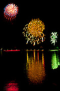 Fireworks across the harbour on Lake of the Woods during the annual festival<br /> Kenora<br /> Ontario<br /> Canada