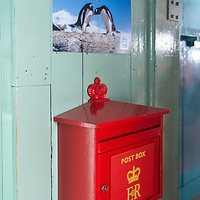 """Visitors are able to send mail via the """"Penguin Post Office"""" which is run by the British postal system from Port Lockroy, Antarctica, where the former British Base A is now used as a museum, gift shop, and research station."""