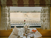Lunch table in teh restaurant cart on the Palace on Wheels, a vintage luxury train crossing Rajahstan province.