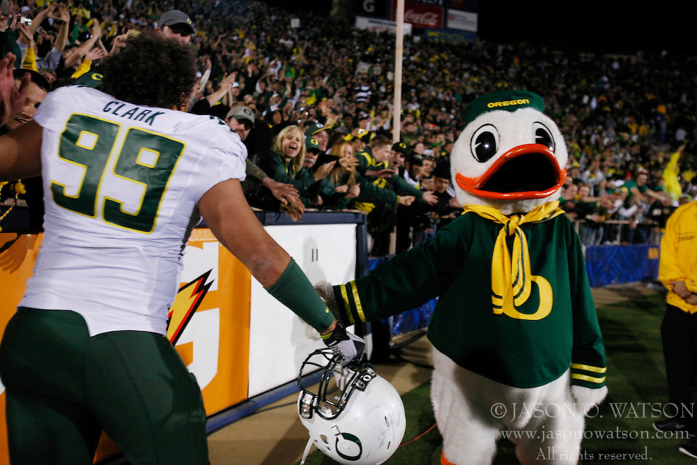 November 13, 2010; Berkeley, CA, USA;  The Oregon Ducks mascot celebrates with defensive tackle Zac Clark (99) and fans after the game against the California Golden Bears at Memorial Stadium. Oregon defeated California 15-13.