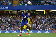 Michy Batshuayi of Chelsea in action while being watched by Peter Hartley of Bristol Rovers. EFL Cup 2nd round match, Chelsea v Bristol Rovers at Stamford Bridge in London on Tuesday 23rd August 2016.<br /> pic by John Patrick Fletcher, Andrew Orchard sports photography.