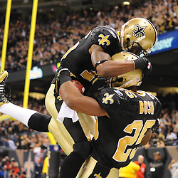 16 January 2010:  New Orleans Saints running back Reggie Bush (25) celebrates with wide receiver Courtney Roby following a 83-yard touchdown punt return during a 45-14 win by the New Orleans Saints over the Arizona Cardinals in a 2010 NFC Divisional Playoff game at the Louisiana Superdome in New Orleans, Louisiana.