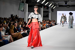 © Licensed to London News Pictures. 03/06/2018. LONDON, UK.  A model presents a look by Amelia Russell from Leeds Arts University on the opening day of Graduate Fashion Week taking place at the Old Truman Brewery in East London.  The event presents the graduation show of up and coming fashion designers from UK and international universities.  Photo credit: Stephen Chung/LNP