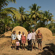 Farmers next to a hay stack in rural India.