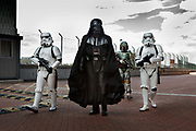 Star Warriors group as storm troopers led by Darth Vader from Starwars, (members of  the charity heroes alliance) attending the London Film and Comic Con LFCC is a convention held annually in London that focuses on films, cult television and comics. The convention holds a large dealers hall selling movie, comic and science fiction related memorabiliaand original film props, along with free guest talks, professional photoshoots, autograph sessions, displays. Many of the visitors / attendeesarrive dressed up as their favourite comic and sci-fi characters in the most outlandish costumes which draws from the award-winning formula of innovative gameplay.<br /> The Heroes Alliance is an exclusive professional organization, providing high quality 'lookalike' comic book characters to charities, organizations and events.
