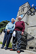 Isles of Scilly, 21 May 2009: Brian and Anne Horrell stand outside the Parish Church of St Mary's, Hugh Town, on the Isles of Scilly. Photo by Peter Horrell / http://peterhorrell.com