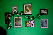 """Religious relics inside a house at the Roma part of the district """"Podsadek"""" in eastern Slovakia. The city of Stara Lubovna is located about 100 km from Kosice in northeast Slovakia. The town has a population of 16350, of whom 2 060 (13%) are of Roma origin. The majority of Roma live in the Podsadek district, where 980 (74%) out of 1330 inhabitants are Roma."""