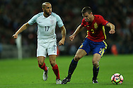Andros Townsend of England (l) challenges Cesar Azpilicueta of Spain. England v Spain, Football international friendly at Wembley Stadium in London on Tuesday 15th November 2016.<br /> pic by John Patrick Fletcher, Andrew Orchard sports photography.