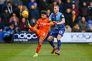 Luton Town defender James Justin performs an overhead kick past Wycombe Wanderers defender Jason McCarthy  during the EFL Sky Bet League 1 match between Luton Town and Wycombe Wanderers at Kenilworth Road, Luton, England on 9 February 2019.