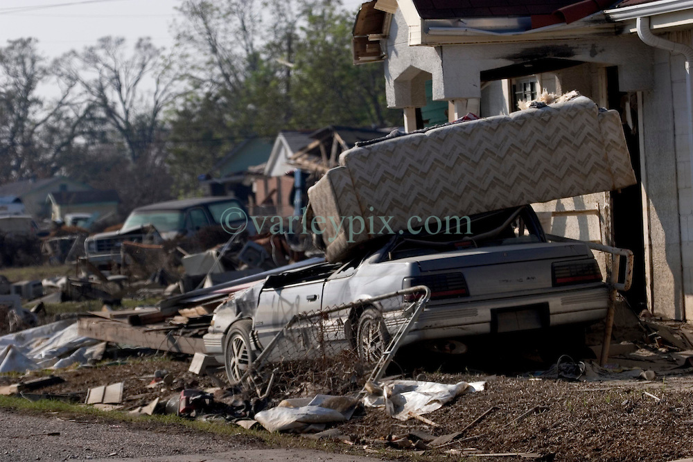 30 Sept, 2005.  New Orleans, Louisiana. Lower 9th ward.  Hurricane Katrina aftermath. <br /> The remnants of the lives of ordinary folks, now covered in mud as the flood waters remain. a couch  sits atop a car, dumped by the floods. <br /> Photo; ©Charlie Varley/varleypix.com