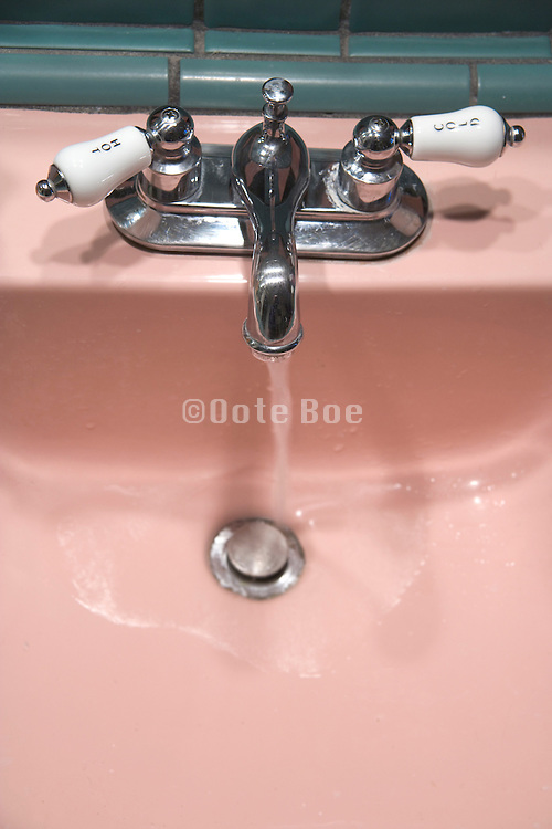 an old style bathroom water tap with running water