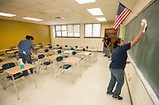 HISD staff work to prepare North Forest High School for students, July 1, 2013.