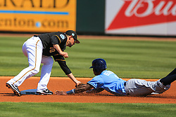 March 10, 2017 - Bradenton, Florida, U.S. - WILL VRAGOVIC   |   Times.Tampa Bay Rays shortstop Tim Beckham (1) tagged by Pittsburgh Pirates shortstop Jordy Mercer (10) attempting to steal second in the first inning of the game between the Pittsburgh Pirates and the Tampa Bay Rays at LECOM Park in Bradenton, Fla. on Friday, March 10, 2017. (Credit Image: © Will Vragovic/Tampa Bay Times via ZUMA Wire)