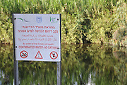 Israel, Hadera stream a seasonal watercourse nature reserve Contaminated water warning sign