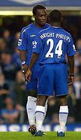 Photo: Daniel Hambury.<br /> Chelsea v West Bromwich Albion. The Barclays Premiership.<br /> 24/08/2005.<br /> Chelsea's Michael Essien and Shaun Wright-Phillips discuss tactics before kick off.